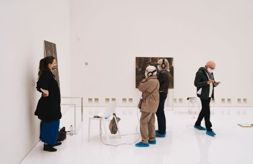 people observing art in a museum space