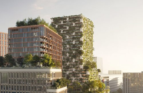 green towers in urban landscape